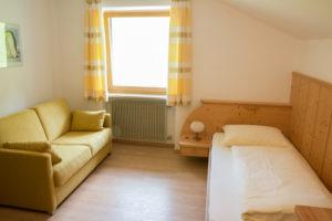 Einzelzimmer mit Couch